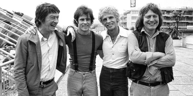 FILE - British actor John Hurt, from left, American actor Brad Davis, writer Billy Hayes and British director Alan Parker appear in Cannes, France for a screening of their film