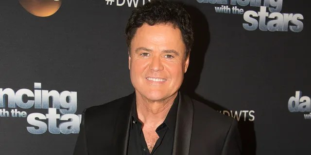Donny Osmond detailed facing potential paralysis following back injury and surgery.