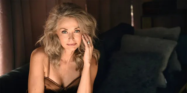 Model Kathy Jacobs poses for a portrait at her home in Calabasas, Calif. on Friday, July 17, 2020. The star made her Sports Illustrated swimsuit issue debut at age 56.