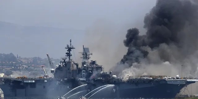 A fire burns on the amphibious assault ship USS Bonhomme Richard at Naval Base San Diego on July 12, 2020 in San Diego, California. There was an explosion on board the ship with multiple injuries reported. (Photo by Sean M. Haffey/Getty Images)