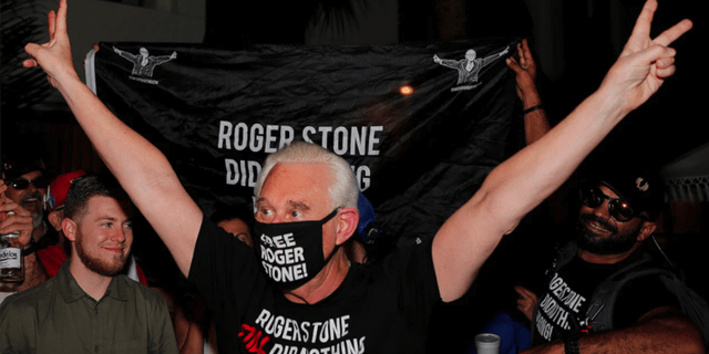 Roger Stone reacts outside his Fort Lauderdale, Fla., home tonight after President Trump commuted his federal prison sentence. (REUTERS/Joe Skipper)