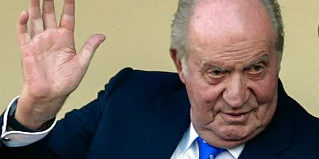 FILE: Spain's former King Juan Carlos waves at the bullring in Aranjuez, Spain.