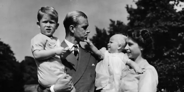FILE - In this August 1951 file photo, Clarence House with Queen Elizabeth II of Britain, then Princess Elizabeth, her husband Prince Philip, Duke of Edinburgh, and their children Prince Charles and Princess Anne, standing at the royal couple's London residence Huh.  (AP Photo / Eddie Worth, File)