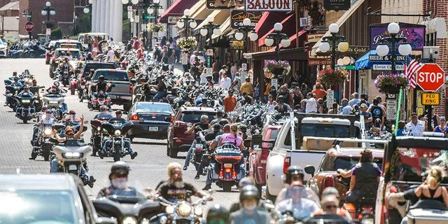 Motorcyclists ride through downtown Deadwood, South Dakota during the 80th Annual Sturgis Motorcycle Rally on August 8, 2020. (Photo by Michael Ciaglo/Getty Images)