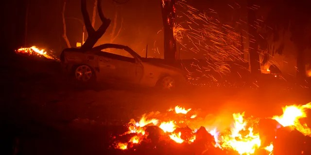 A burned vehicle is seen in the Lake Hughes fire in Angeles National Forest on Thursday, Aug. 13, 2020, north of Santa Clarita, Calif.