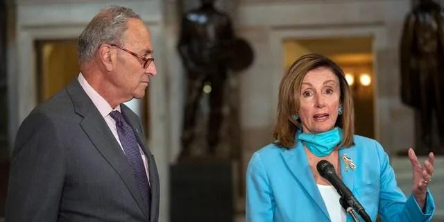 House Speaker Nancy Pelosi of Calif., joined by Senate Minority Leader Sen. Chuck Schumer of N.Y., speaks to media on Capitol Hill in Washington, Wednesday, Aug. 5, 2020. (AP Photo/Carolyn Kaster)