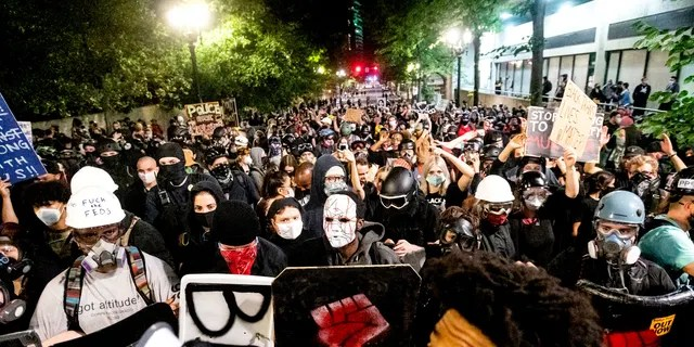 Black Lives Matter protesters march through Portland after rallying at the Mark O. Hatfield United States Courthouse on Sunday. (AP)