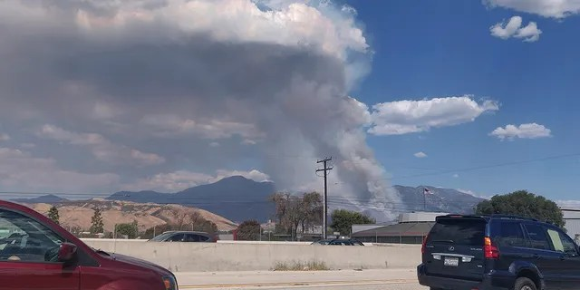 A plume of smoke from the El Dorado Fire is seen from the Interstate 10 in Loma Linda, Calif., Saturday, Sept. 5, 2020. (AP Photo/Ringo H.W. Chiu)