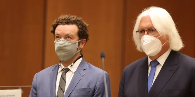 Danny Masterson, left, stands with his attorney, Thomas Mesereau as he is arraigned on rape charges at Los Angeles Superior Court, in Los Angeles, Calif. on Friday, Sept. 18, 2020.