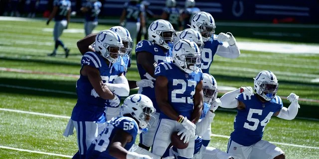 Indianapolis Colts' Kenny Moore II (23) celebrates an interception with teammates during the second half of an NFL football game against the Minnesota Vikings, Sunday, Sept. 20, 2020, in Indianapolis. (AP Photo/Michael Conroy)