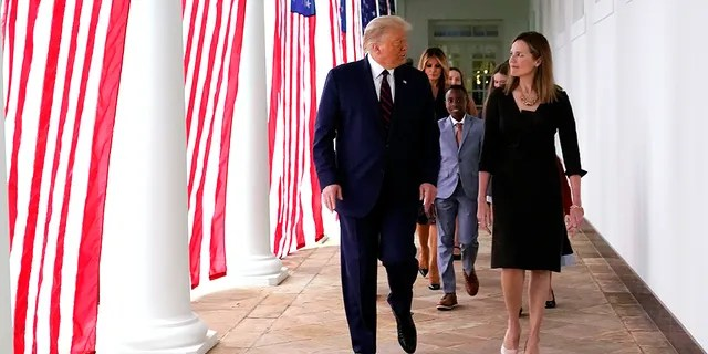 President Donald Trump walks along the Colonnade with Judge Amy Coney Barrett after a news conference to announce Barrett as his nominee to the Supreme Court, in the Rose Garden at the White House, Sept. 26, 2020, in Washington. (Associated Press)