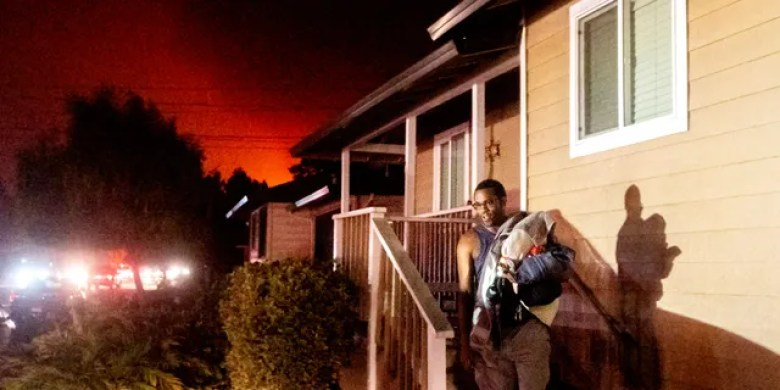 Eddy Whitmore evacuates from his Santa Rosa, Calif., home as the Shady Fire approaches on Sunday, Sept. 27, 2020.