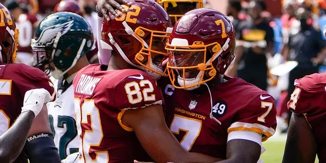 Washington Football Team tight end Logan Thomas (82) celebrates his touchdown against Philadelphia Eagles with teammate quarterback Dwayne Haskins (7), during the first half of an NFL football game, Sunday, Sept. 13, 2020, in Landover, Md. (AP Photo/Susan Walsh)