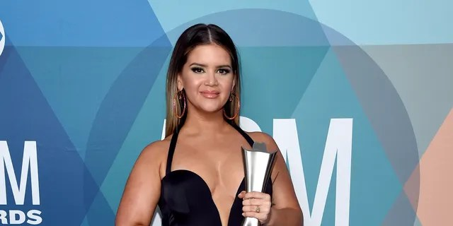 Maren Morris poses with the Female Artist of the Year award at the 55th Academy of Country Music Awards at the Grand Ole Opry on September 16, 2020 in Nashville, Tenn. (Photo by John Shearer/ACMA2020/Getty Images for ACM)