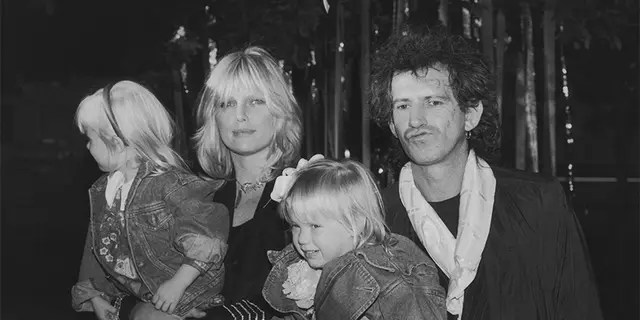 Guitarist Keith Richards of the Rolling Stones arrives at the Big Apple Circus at the Lincoln Center's Damrosch Park with his wife Patti and their daughters Theodora and Alexandra, November 1988.