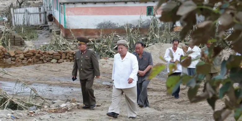 In this Saturday, Sept. 5, 2020, photo provided by the North Korean government, North Korea leader Kim Jong Un visits a damaged area in the South Hamgyong province, North Korea, following a typhoon known as Maysak.