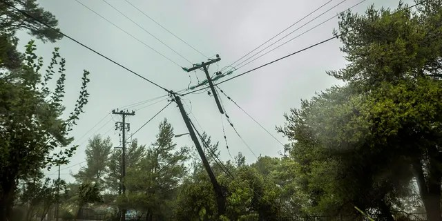Damaged power and telecommunications lines are seen during a storm at the port of Argostoli, on the Ionian island of Kefalonia, western Greece, Friday, September 18, 2020.