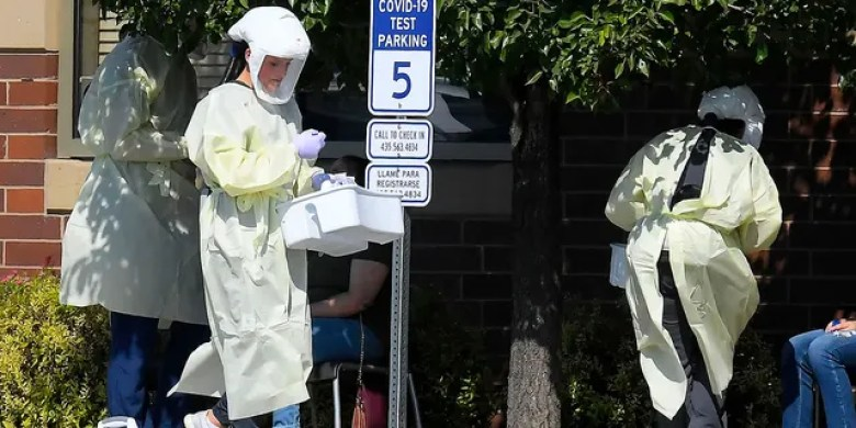 Workers test Utah State University students for COVID-19 on Aug. 30, in Hyde Park, Utah. Students from four dorms were tested and quarantined after the virus was detected in the wastewater from those buildings. (Eli Lucero/The Herald Journal via AP)