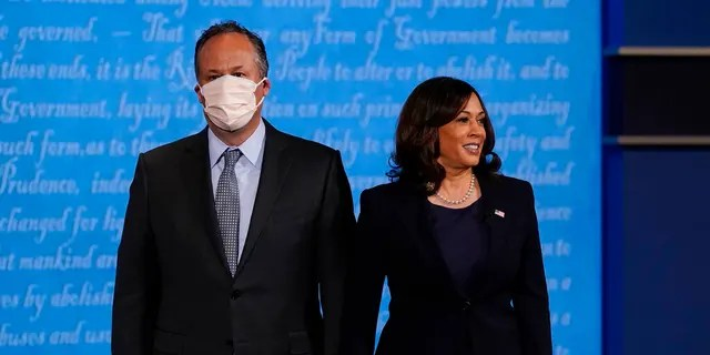 Democratic vice-presidential candidate Sen. Kamala Harris, D-Calif., stands with her husband Douglas Emhoff during the vice presidential debate.(AP Photo/Patrick Semansky)