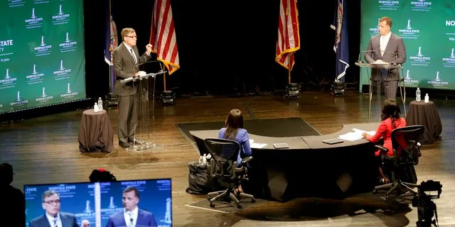 Sen. Mark Warner, left, D-Va., and his Republican challenger, Daniel Gade, right, go head to head over issues of racial inequalities during the U.S. Senatorial debate at Norfolk State University, Saturday, Oct. 3, 2020, in Norfolk, Va. (Associated Press)