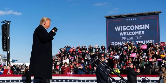 President Donald Trump arrives to speak at a campaign rally at Green Bay Austin Straubel International Airport, Friday, Oct. 30, 2020, in Green Bay, Wis. (AP Photo/Alex Brandon)