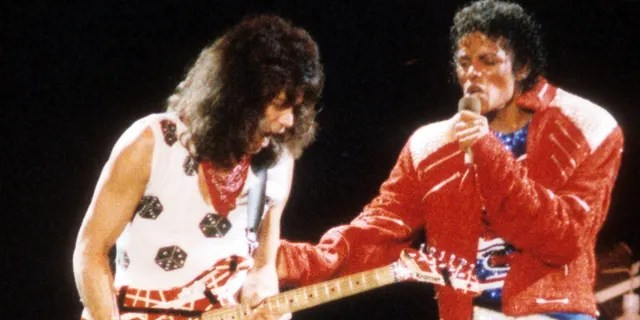 """Guitarist Eddie Van Halen joins pop star Michael Jackson on stage to perform his hit song """"Beat It"""" during The Jacksons Victory Tour on July 14, 1984 at Texas Stadium in Dallas. (Getty Images)"""