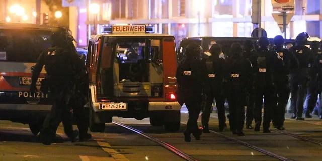 Police officers walk at the scene after gunshots were heard in Vienna.(Photo/Ronald Zak)