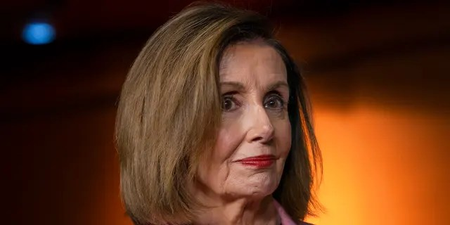 FILE: Speaker of the House Nancy Pelosi, D-Calif., leads other House Democrats to discuss H.R. 1, the For the People Act, which passed in the House but is being held up in the Senate, at the Capitol in Washington, Friday, Sept. 27, 2019. (AP Photo/J. Scott Applewhite)