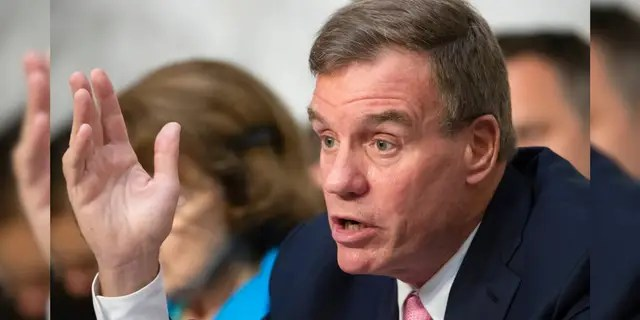 U.S. Sen. Mark Warner, D-Va., is seen on Capitol Hill, July 25, 2018. (Associated Press)