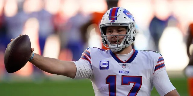 Buffalo Bills quarterback Josh Allen celebrates after scoring a touchdown during the first half of an NFL football game against the Denver Broncos, Saturday, Dec. 19, 2020, in Denver. (AP Photo/Jack Dempsey)