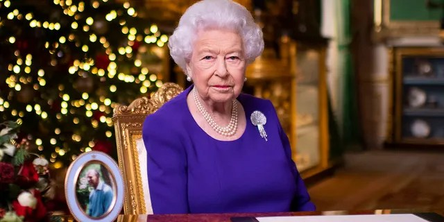 In this undated photo issued on Friday, Dec. 25, 2020, Britain's Queen Elizabeth II records her annual Christmas broadcast in Windsor Castle, Windsor, England.