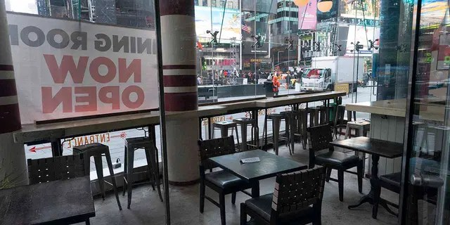 Dos Caminos restaurant is closed for indoor dining, Tuesday, Dec. 15, 2020, in New York. A ban on indoor dining at New York City restaurants was enacted Monday by officials trying to slow the resurgence of the coronavirus. (AP Photo/Mark Lennihan)