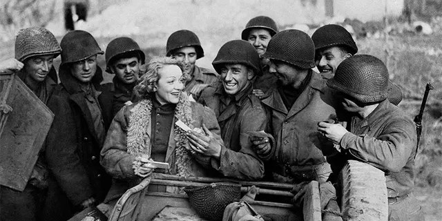 During World War II, Marlene Dietrich defied Adolf Hitler's call to return home to Germany, performing instead for U.S. troops in Berlin.