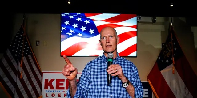 Sen. Rick Scott, R-Fla., speaks during a campaign rally for Republican candidates for U.S. Senate Sen. Kelly Loeffler and Sen. David Perdue on Friday, Nov. 13, 2020, in Cumming, Ga. (AP Photo/Brynn Anderson)