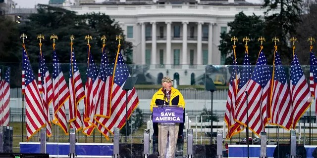 """With the White House in the background, Rep. Mo Brooks, R-Ala., speaks Wednesday, Jan. 6, 2021, in Washington, at a rally in support of President Donald Trump called the """"Save America Rally."""" (AP Photo/Jacquelyn Martin)"""