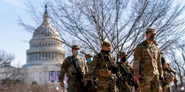 Members of the National Guard patrol outside the Capitol Building on Capitol Hill in Washington, Thursday, Jan. 14, 2021. (Associated Press)
