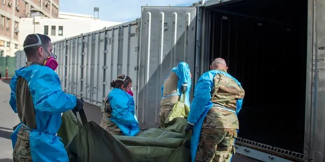 National Guard members assist with processing COVID-19 deaths and placing them into temporary storage at the medical examiner-coroner's office in Los Angeles on Jan. 12, 2021. (Los Angeles County Department of Medical Examiner-Coroner via AP, File)