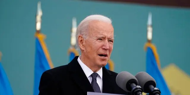 "President-elect Joe Biden speaks at the Major Joseph R. ""Beau"" Biden III National Guard/Reserve Center, Tuesday, Jan. 19, 2021, in New Castle, Del. Biden has so far refused to compromise on his coronavirus relief deal in negotiations with congressional Republicans. (AP Photo/Evan Vucci)"