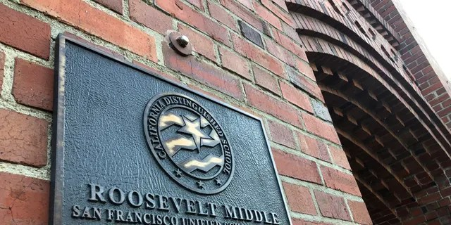 A plaque for Roosevelt Middle School was spotted outside the school in San Francisco on Wednesday, January 27, 2021.  (AP Photo / Heaven Delhi)