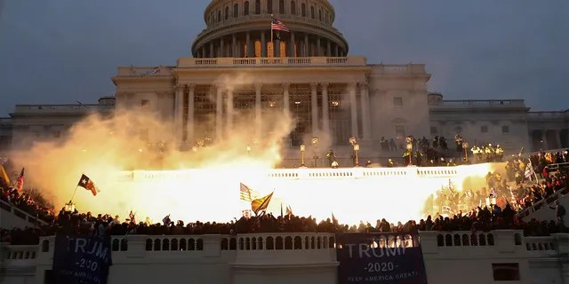 An explosion caused by a police munition is seen while supporters of U.S. President Donald Trump gather in front of the U.S. Capitol Building in Washington, D.C., Jan. 6, 2021.