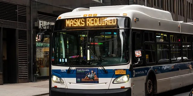 An MTA bus displays the message 'Masks Required' as New York City continues to reopen its efforts following restrictions imposed to curb the spread of coronavirus.  (Photo by Noam Galai / Getty Images)