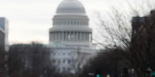 A National Guard stands on patrol outside the Capitol as security is heightened ahead of President-elect Joe Biden's inauguration ceremony Monday, Jan. 18, 2021, in Washington.