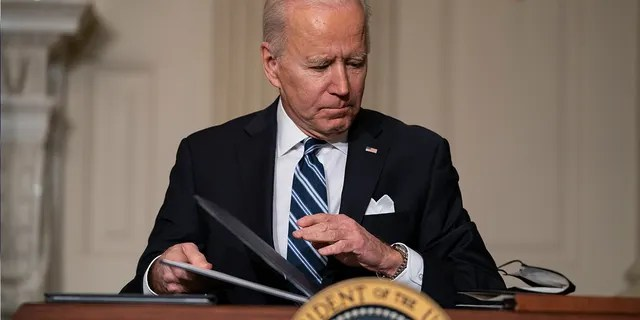 In this Jan. 27, 2021, file photo President Joe Biden signs a series of executive orders on climate change, in the State Dining Room of the White House in Washington. Biden's $1.9 trillion coronavirus stimulus plan is almost certain not to get any support from congressional Republicans. (AP Photo/Evan Vucci, File)
