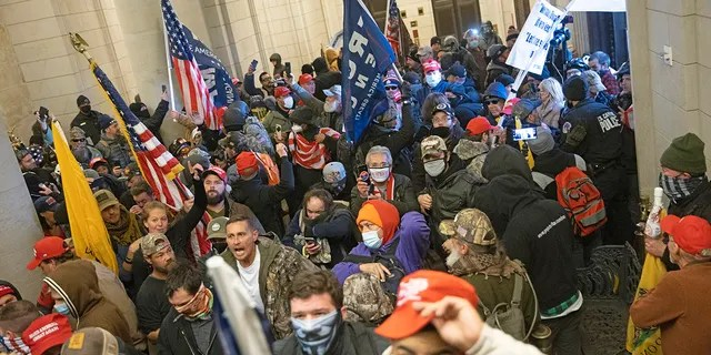 WASHINGTON, DC - JANUARY 06: Protesters supporting U.S. President Donald Trump gather near the east front door of the U.S. Capitol after groups breached the building's security on January 06, 2021 in Washington, DC. Pro-Trump protesters entered the U.S. Capitol building during demonstrations in the nation's capital. (Photo by Win McNamee/Getty Images)