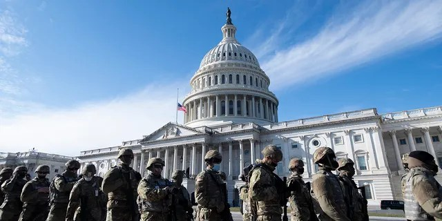 National Guard troops stand outside the U.S. Capitol before a dress rehearsal for the 59th inaugural ceremony for President-elect Joe Biden and Vice President-elect Kamala Harris at the Capitol, Monday, Jan. 18, 2021, in Washington. (Associated Press)
