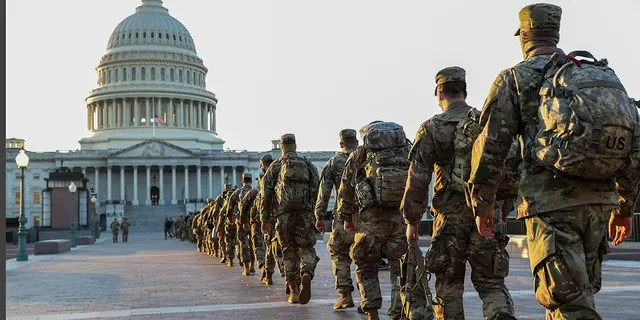 Members of the U.S. National Guard arrive at the U.S. Capitol on January 12, 2021 in Washington, DC. The Pentagon is deploying as many as 15,000 National Guard troops to protect President-elect Joe Biden's inauguration on January 20, amid fears of new violence. (Photo by Tasos Katopodis/Getty Images)