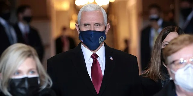 Vice President Mike Pence arrives at the inauguration of President-elect Joe Biden on the West Front of the U.S. Capitol on Wednesday, Jan. 20, 2021 in Washington.