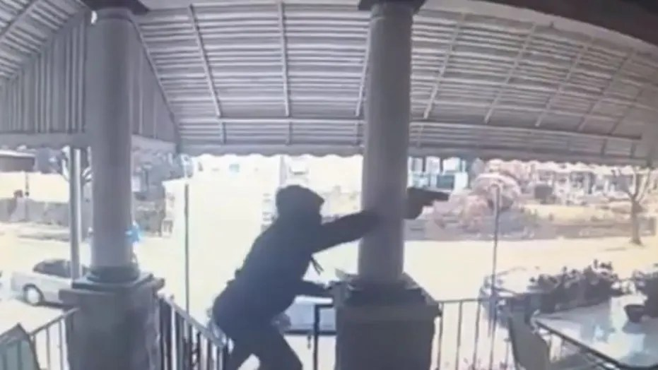 WATCH:Philadelphia police searching for gunmen caught on video firing at least 20 shots at man on porch