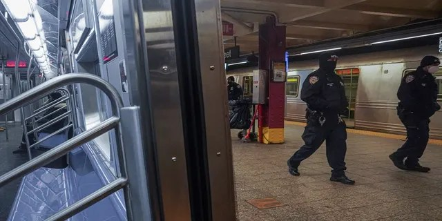 Police patrol the A line subway train bound to Inwood, after NYPD deployed an additional 500 officers into the subway system following deadly attacks, Saturday Feb. 13, 2021, in New York. (AP Photo/Bebeto Matthews)