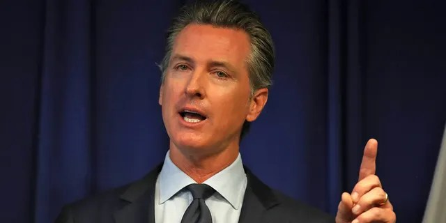 California Gov. Gavin Newsom speaks during a news conference at the California justice department on Sept. 18, 2019 in Sacramento, California. Newsom's state has seen a population exodus in recent years, with many blaming high taxes and a high cost of living on Democratic leadership. That could cost the state a seat in the House of Representatives when the results of the 2020 Census come out Monday.